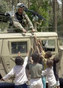 Iraqi Children gathered around a US tank