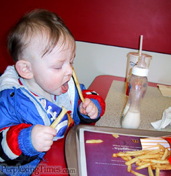 Baby eating McDonalds fries - http://www.perplexingtimes.com/media/story153.jpg